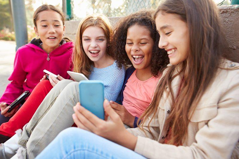 bigstock-young-girls-using-digital-tabl-92608301-edit.jpg