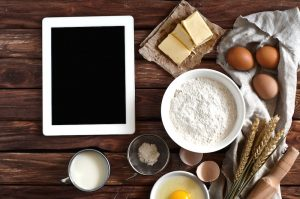 bigstock-white-tablet-computer-with-bla-99698453.jpg